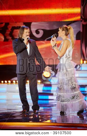 MOSCOW - NOV 30: Joint performance of jury chairman A.Inshakov and singer Ingrid on stage of Russian beauty - 2011 contest, 30 November 2011, Moscow, Russia.
