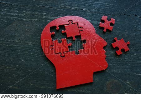 Human Head Shape With Extracted Puzzle Pieces. Alzheimer Disease And Memory Problems.
