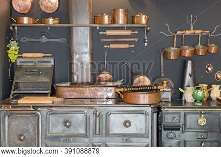 Copper Pots And Pans And Other Kitchen Utensils In An Antique Metal Kitchen.