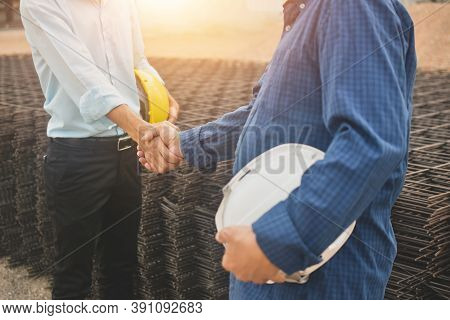 Man Holding Hard Hat Are Shake Hand On Site Construction Concept Teamwork Business Worker