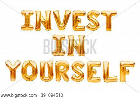 Words Invest In Yourself Made Of Golden Inflatable Balloons Isolated On White. Helium Gold Foil Ball