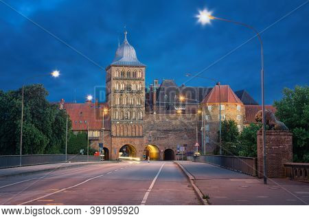 Lubeck, Germany. Burgtor - Northern Gate Of The Old Town (hdr Image At Dusk)