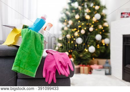 Cleaning Before Christmas. Multicolored Cleaning Supplies. Sponges, Rags And Spray With Festive Deco