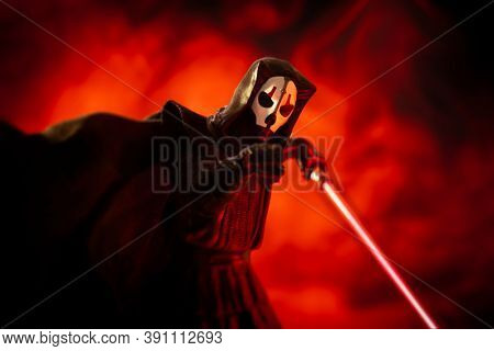 OCT 17 2020 -  Sith lord Darth Nihilus with lightsaber and fire background - Hasbro action figure