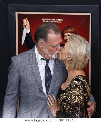 NEW YORK-NOV 18: Actress Helen Mirren kisses husband Taylor Hackford at the premiere of