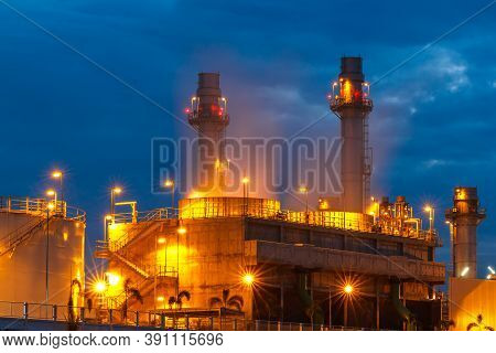 Petrochemical Oil Refinery Plant With Blue And Twilight Image Of A Power Plant In A Beautiful Evenin