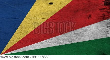 Flag Of Seychelles On Wooden Plate Background. Grunge Seychelles Flag Texture, Five Oblique Bands Of