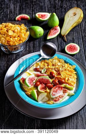 Healthy Morning Breakfast: Blue Bowl With Natural Plain Yogurt With Crispy Corn Flakes, Figs, Pear S