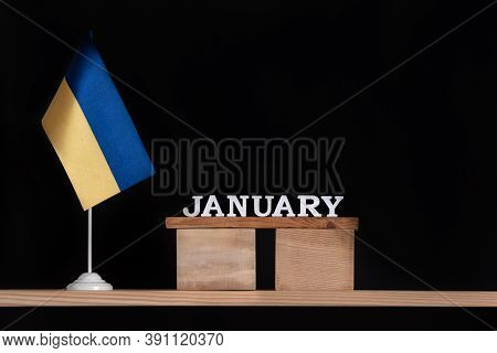 Wooden Calendar Of January With Ukrainian Flag On Black Background. Dates In Ukraine In January.