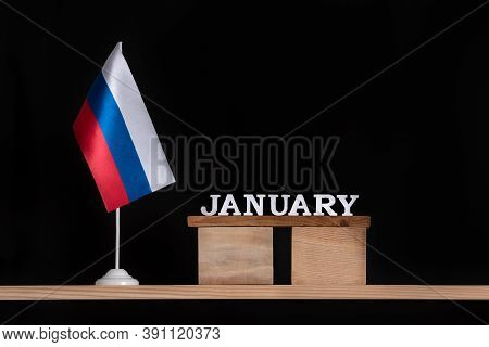 Wooden Calendar Of January With Russian Flag On Black Background. Dates In Russia In January.