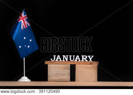 Wooden Calendar Of January With Australian Flag On Black Background. Holidays Of Australia In Januar