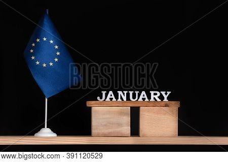 Wooden Calendar Of January With Flag Eu On Black Background. Holidays Of European Union In January.