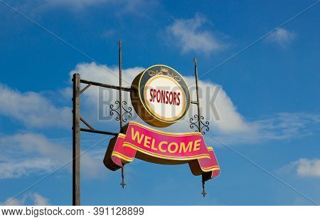 Sponsors Welcome Sign. Street Signs With Text 'sponsors Welcome' On Metal Pole. Directional Road. Bl
