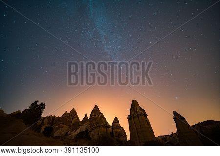 Cappadocia At Night. Fairy Chimneys Under The Stary Night Sky.