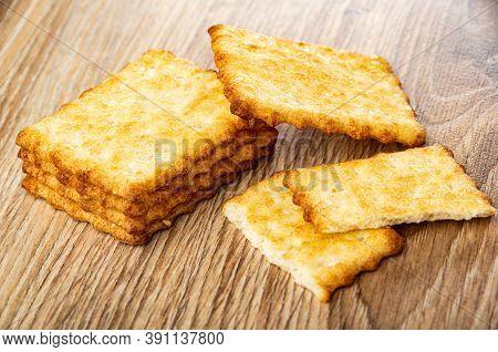 Few Crunchy Cookies With Sesame, Broken Cracker On Wooden Table