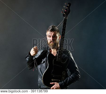 Music Party. Sexy Guitarist With Musical Instrument. Handsome Rock Star In Leather Jacket. Music Con