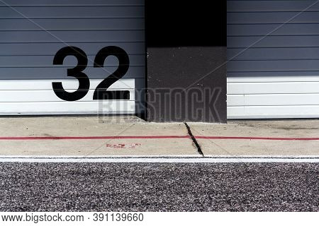 White Metal Garage With Large Black Number On Door, Sunny Summer Day, Copy Space