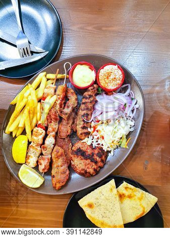 tasty kabobs grilled meat and vegetables skewers on a slate plate