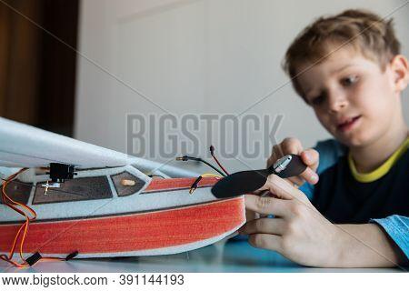 Boy Making Model Of Plane, Kids Engineering