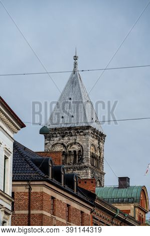 One Of The Steeples Of Lund Cathedral Visible High Above The Roof Tops Of The University Town In Sou