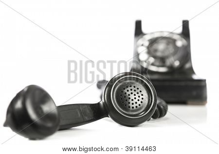 Vintage phone and receiver on white