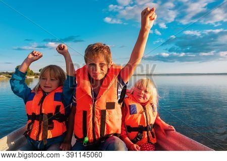 Happy Kids In Boat Ride On Lake