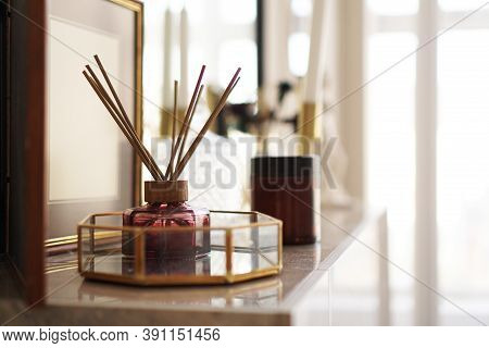 Aroma Sticks With Glass Stand Over Bright Background. Home Fragrance.