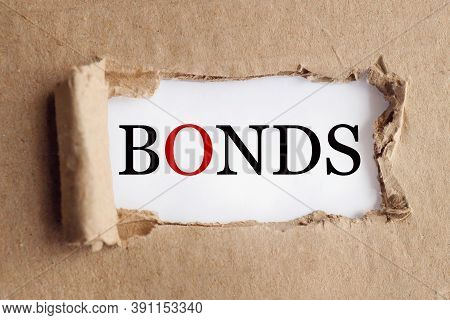 Bonds, Text On Torn Paper On A White Backing
