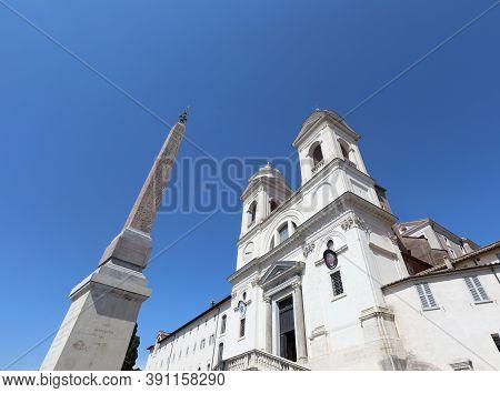 Ancient Obelisk In Rome And Church Of Trinita Dei Monti In Italy