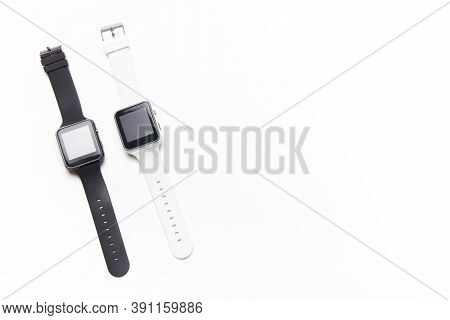 Electronic Wrist Watch On A White Background . White And Black Wrist Watches. Womens And Mens Watche
