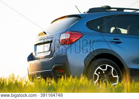 Close Up Of Blue Off Road Car On Green Grass. Traveling By Auto, Adventure In Wildlife, Expedition O