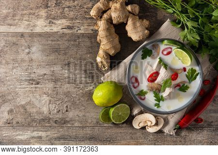 Traditional Thai Food Tom Kha Gai In Bowl And Ingredients On Wooden Table.top View. Copy Space