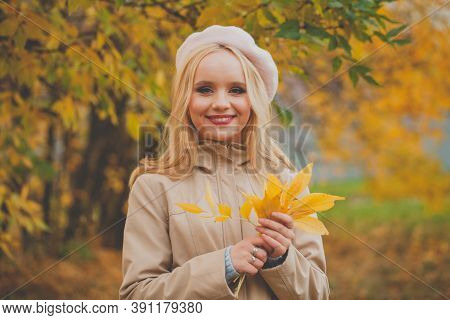 Portrait Of Adorable Young Happy Blonde Woman Wearing French Beret With Autumn Leaves Outddor