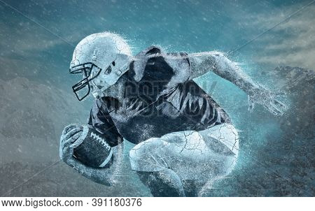 Frozen American football sportsman player with ball in action under  rain background. Sport, proud footballer in white helmet and red t-shirt ready to play.
