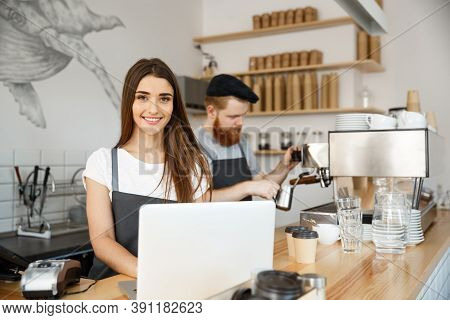 Coffee Business Concept - Beautiful Caucasian Bartender Barista Or Manager Working And Planing In La
