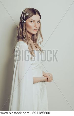Perfect Woman Elf In White Dress. Mysterious Elven Sorceress Princess Halloween Character Costume