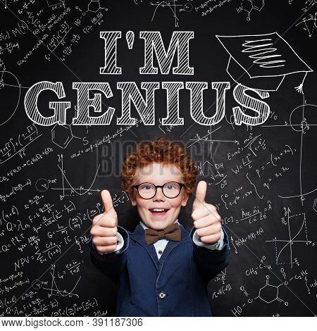 Genius Child Boy Having Fun. Happy Boy With Red Hair