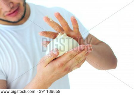 The Dough In The Hands Of The Baker. Unrecognizable Person. Close-up. Out Of Focus. Bakers Hands Clo