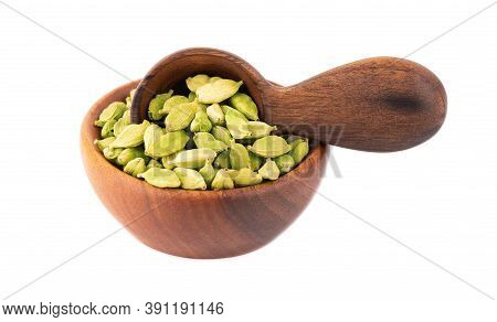 Cardamom Seeds In Wooden Bowl And Spoon, Isolated On White Background. Pile Of Green Cardamom.