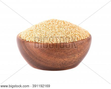 Amaranth Seeds In Wooden Bowl, Isolated On White Background. Organic Dry Raw Amaranth Beans.