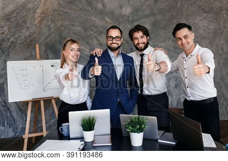 Business Leaders With Employees Group Showing Thumbs Up Looking At Camera, Happy Professional Multic