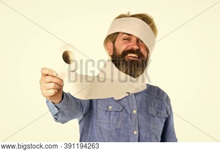 Man Hold Toilet Paper. Hipster Guy Having Fun. Softness Strength And Absorbency. Prevent Toilet Pape