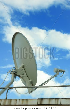 A communication antenna with blue sky background poster