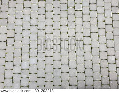 View On Paving Stone Road. Pavement Of Granite Texture. Abstract Background Of Pavement.