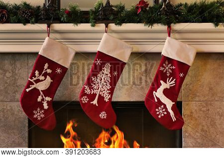 Cozy Christmas Fireplace With Three Red Stockings