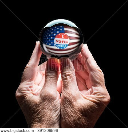 Senior Caucasian Hands Holding A Crystal Futures Or Fortune Telling Ball With I Voted Sticker To Pre
