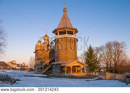 The Old Wooden Church Of Dmitry Solunsky In The Light Of The Setting Sun On A April Evening. Shchele