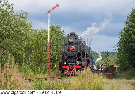 Ruskeala, Russia - August 15, 2020: Soviet Steam Locomotive Lv-0522 And With The Train
