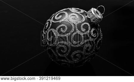 Christmas Ornament Single Red Ball On Black Background. Christmas Ornament Concept. Elegant And Luxu