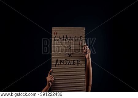 Change, Protest , Mob Or Expression Concept. Person Raised A Corrugated Paper In The Dark. Front Vie